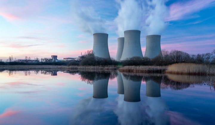 A nuclear power plant at sunset.