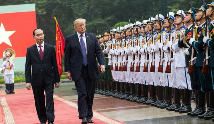 President Trump arrives in Vietnam to discuss trade issues.